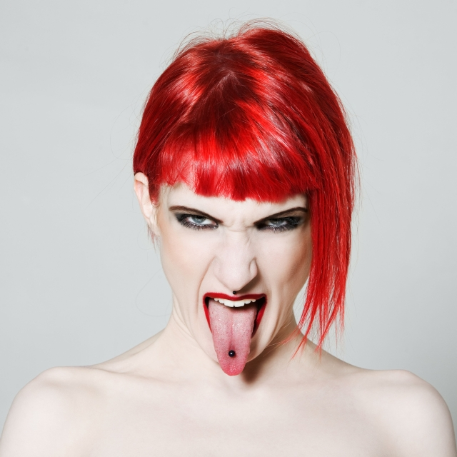 Redhead with tongue piercing